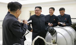 Kim Jong-un inspects a device, or perhaps a model of a bomb.