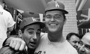Sandy Koufax and Don Drysdale, one of the greatest one-two punches in baseball history, celebrate after defeating the Minnesota Twins in the 1965 World Series.