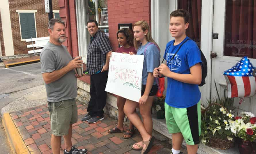 People protesting outside the Red Hen.