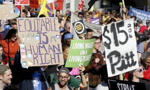 Union organizers, students, and supporters for a $15 an hour wage march in Oakland.