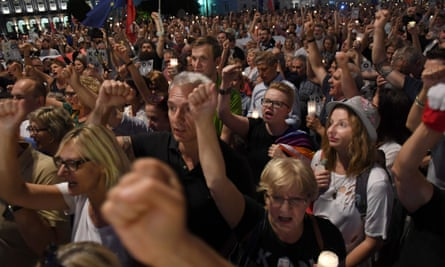 People demonstrate against the Polish government's new measure