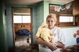 Yojanna, 40, holds five-day old Layla Sussette