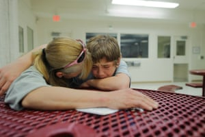 Vinny, 13, cries during a visit with his mother, Eve, at the Bernalillo County juvenile detention centre
