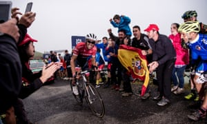 Alberto Contador is cheered on by fans during a Stage 17 ascent
