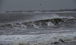 Waves crash in front of the Cape May Lighthouse during a blizzard on Saturday, in Cape May New Jersey.