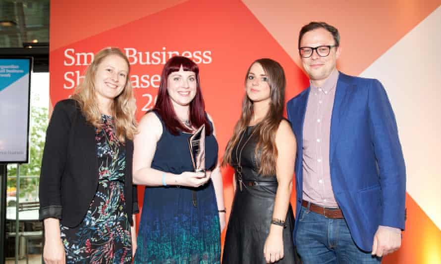 Jessica Walsh and Laura Washington collect award