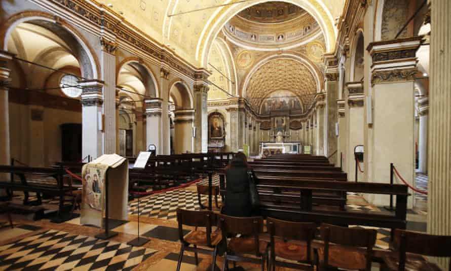 A woman prays in the otherwise empty Santa Maria presso San Satiro church in Milan on Ash Wednesday