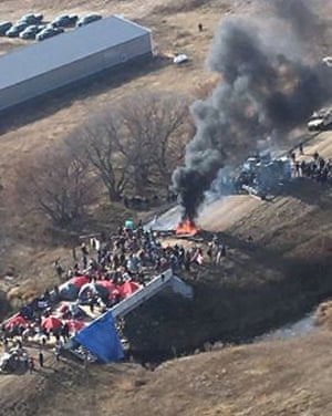 Dakota Access pipeline protesters set the bridge on fire, officials said