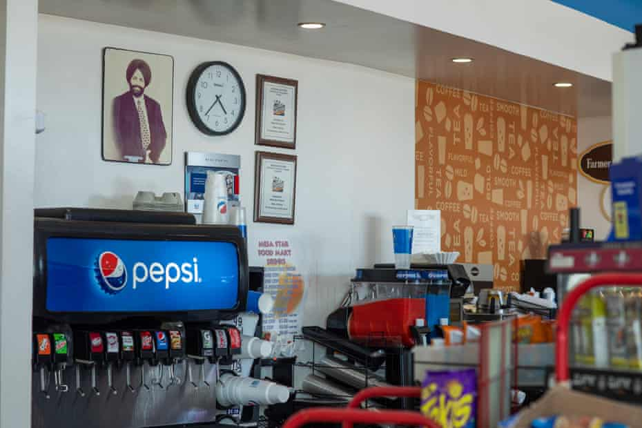 A photograph of Balbir Singh Sodhi is mounted on the wall above the soda fountain in the Mesa Star food mart.