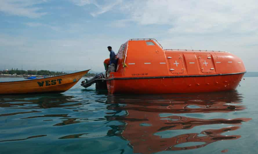 An empty Australian lifeboat that carried asylum seekers turned back by the Australian navy is docked at Pangandaran wharf in western Java island in 2014.