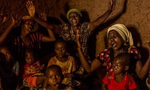 Women and children singing  in Kashojwa village in Uganda