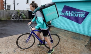 A Deliveroo rider sets off from a Roobox dark kitchen in Hove, Sussex.