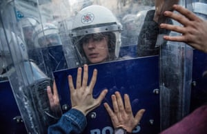 Riot police react during clashes with women's rights activists as they try to march to Taksim Square to protest against gender violence in Istanbul on the UN International Day for the Elimination of Violence against Women.