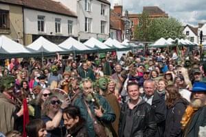 Crowds gather to watch the proceedings