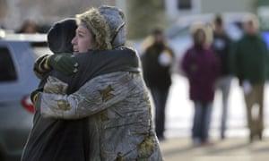 Sarah Rogstad, right, hugs Morgan Rogstad, grade 9, after the school shooting at Oshkosh West high school.