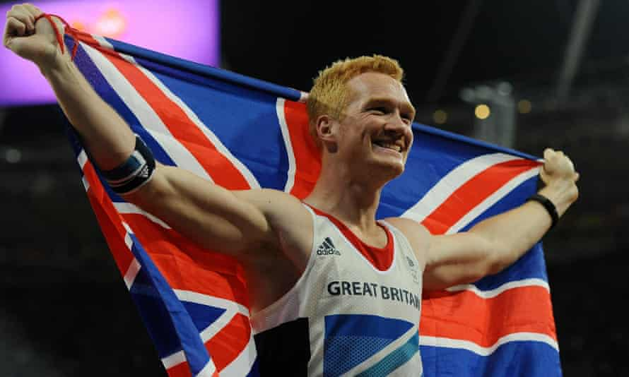 Greg Rutherford celebrates winning gold in the long jump at London 2012. He says: 'The atmosphere in stadiums is going to be very weird.'