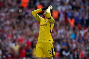 Courtois reacts after missing his penalty.