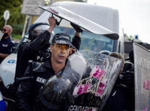 Sofia, Bulgaria. A police officer is egged during ongoing anti-government protests at the parliament building