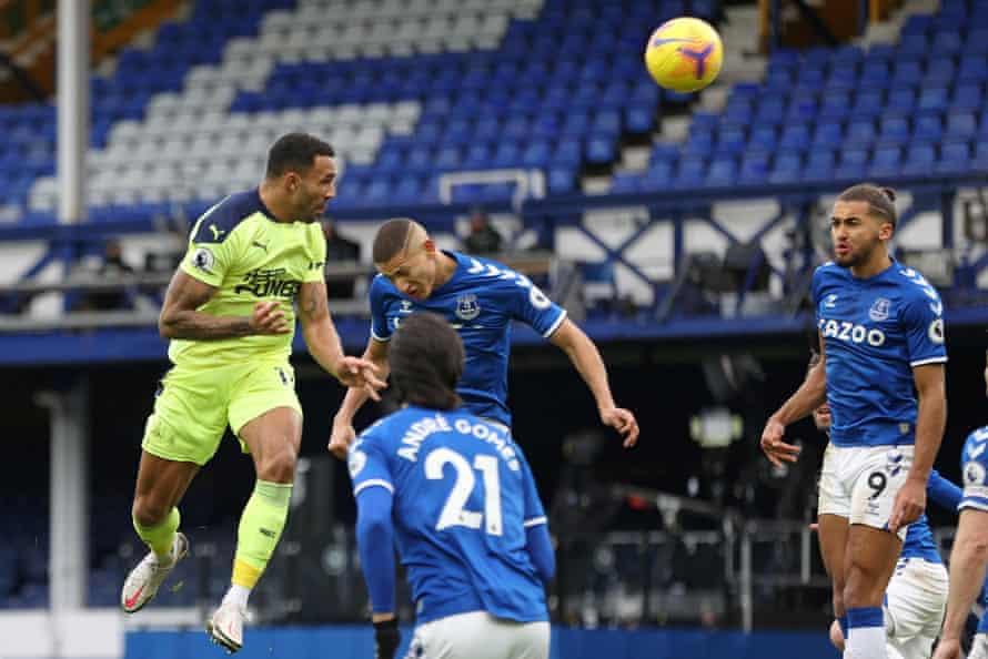Callum Wilson rises highest to head in Newcastle's opening goal.