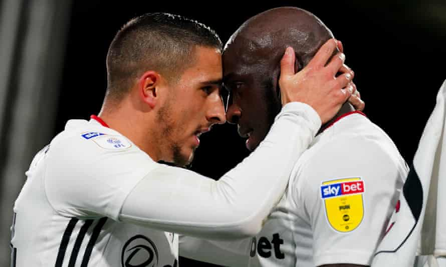 Fulham's Aboubakar Kamara, right, celebrates with Anthony Knockaert after scoring the first of his two goals that secured victory over QPR.