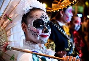 Mexicans dressed up as the macabre character La Catrina, which was created by cartoonist Jose Guadalupe Posada, take part in a Catrinas parade