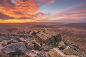Higger Tor   This gritstone knoll overlooks the Burbage Valley in the eastern Peak District, quite close to Sheffield. These rocks are called the Book Stones, and are one of the few gritstone formations that catch the autumn sunrise as the ferns turn to a burnished brown. Peak higgar 18dec 3