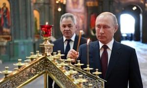 Vladimir Putin, right, with Russian defence minister Sergei Shoigu