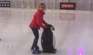 Liverpool Ice Festival little girl with penguin skate aid.