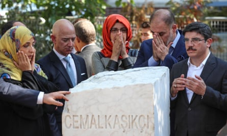 Hatice Cengiz (centre), fiancee of Khashoggi, with Amazon and Washington Post owner, Jeff Bezos (second left), and other and participants by a memorial stone during an event marking Khashoggi's death in Istanbul, October 2019.