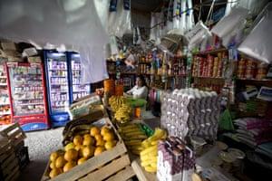 A woman works in a shop in Filo de Caballos.