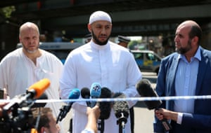 Mahmoud giving a statement to the media following the attack.