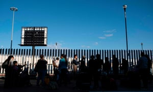 "Asylum seekers wait for their turn to cross to the United States at El Chaparral crossing port on the US-Mexico border in Tijuana, Baja California state, Mexico, on 29 February 2020. In 2018, when a district judge in the ninth circuit blocked Trump restrictions on asylum applications, Trump tweet-raged that ""the 9th Circuit is a complete & total disaster"" and ""out of control"" with ""a horrible reputation."""