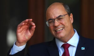 Wilson Witzel gestures as he speaks to the media at Laranjeiras Palace in August.