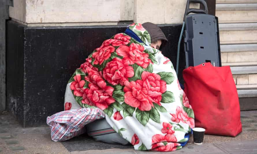 homeless person outside Victoria Station in London