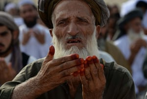 A man offers prayers at the start of Eid al-Fitr in Jalalabad, Afghanistan
