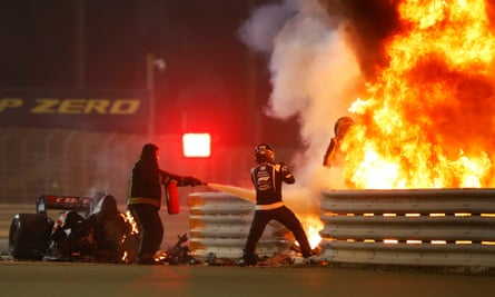 Romain Grosjean emerges from the flames after a horrific crash on the opening lap of the Bahrain Grand Prix