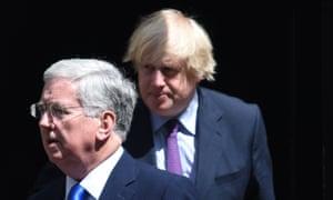 Michael Fallon and Boris Johnson leave Downing Street.