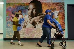 Seniors in Philadelphia carry away donated fans.