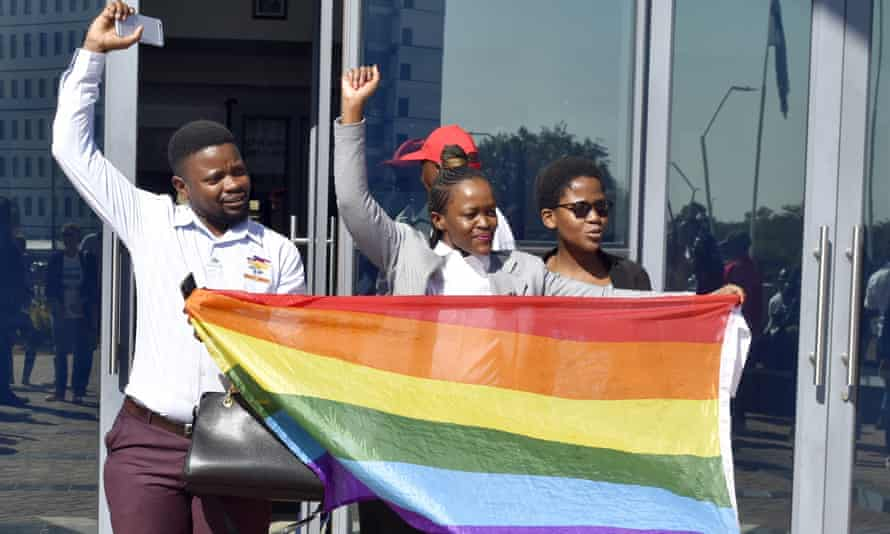 Activists celebrate outside the high court in Gaborone, Botswana, on Tuesday.