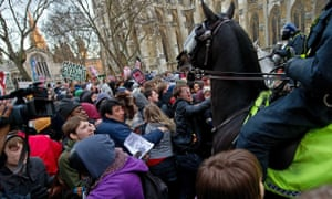 Mounted police confront protesters during student demonstrations in London, on 9 December, 2010.