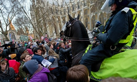 Mounted police drive their horses into protesters during student demonstrations in London in December 2010.