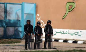Policemen stand guard at a prison in Egypt. Mustafa Kassem's case has trained a spotlight on the dangers of Egyptian prisons.