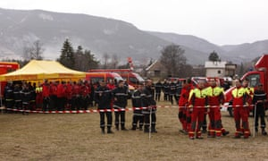 Gendarmerie and French mountain rescue teams arrive near the site of the Germanwings plane crash in the French Alps.
