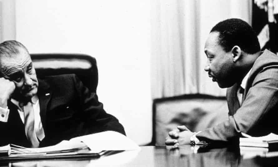 Johnson discussing the Voting Rights Act with Martin Luther King, Jr, in 1965.