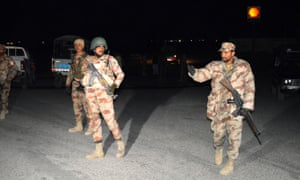 Pakistani soldiers arrive at a terrorist attack site in Quetta, Pakistan, on Tuesday in which at least 12 people including five security personnel were injured.