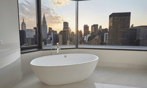Bathtub in penthouse overlooking Manhattan skyline