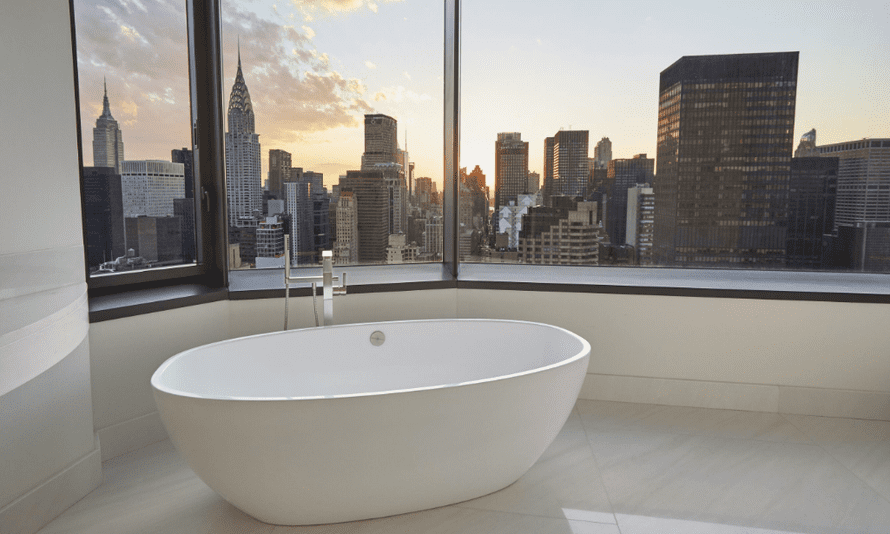 The ensuite bathroom comes complete with a freestanding French marble bathtub.