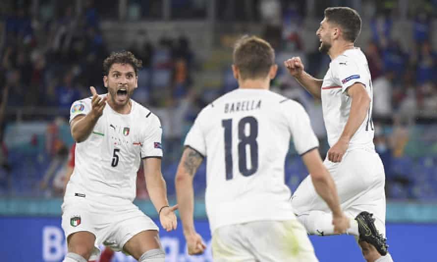 Manuel Locatelli celebrates with Nicolò Barella and Domenico Berardi after an own goal by Turkey's Merih Demiral in Rome.
