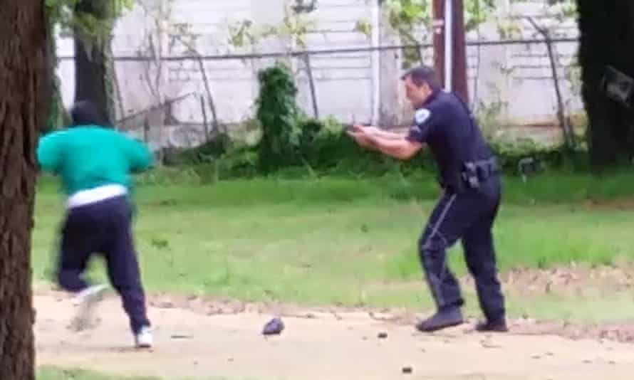 Walter Scott, left, appears to run away from officer Michael Slager, right, in video that appears to show him shooting Scott several times in the back.