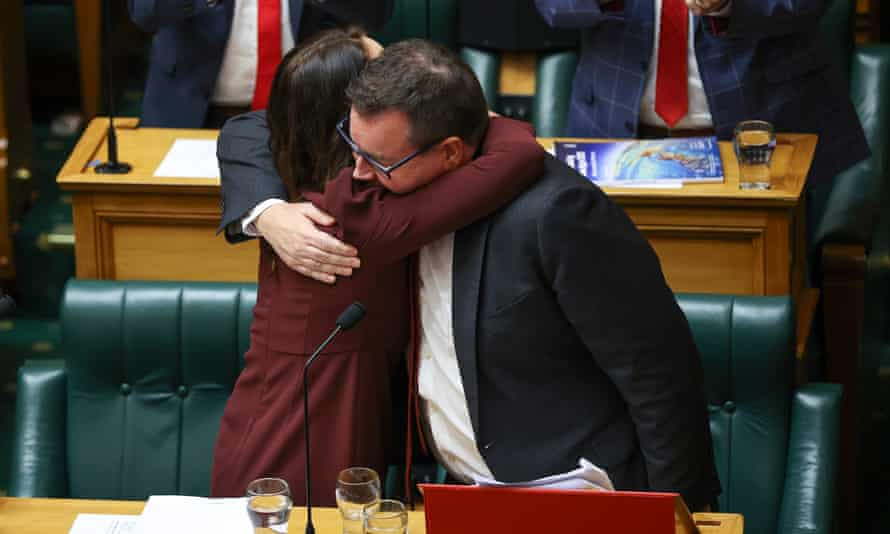 Jacinda Ardern embraces finance minister Grant Robertson after he delivered the budget in parliament on Thursday.